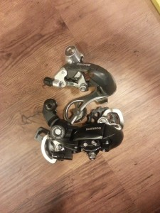 My new Tourney rear derailleur alongside my old Exage rear derailleur (at the moment without its jockey wheels).